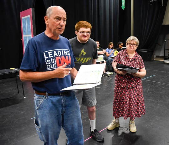 """Senator Weatherbee, played by Rick Converse, his cat played by Sean Stidmon and the senator's assistant, played Janet Schleper rehearse a scene in Understanding Your Pet with Dr. Marla Brett""""  Friday, July 20, at the GREAT Theatre in Waite Park."""