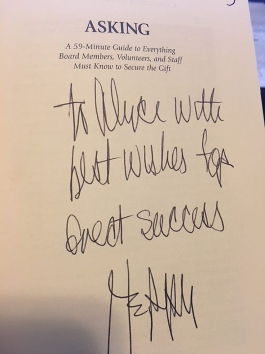 """An autographed copy of """"Asking"""" by Jerry Panas."""