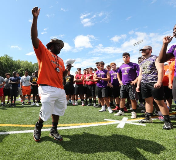 Spring Valley High School head football coach Andrew Delva welcomes local football players to the Phil Bogle Lineman Challenge on Saturday, July 21, 2018.