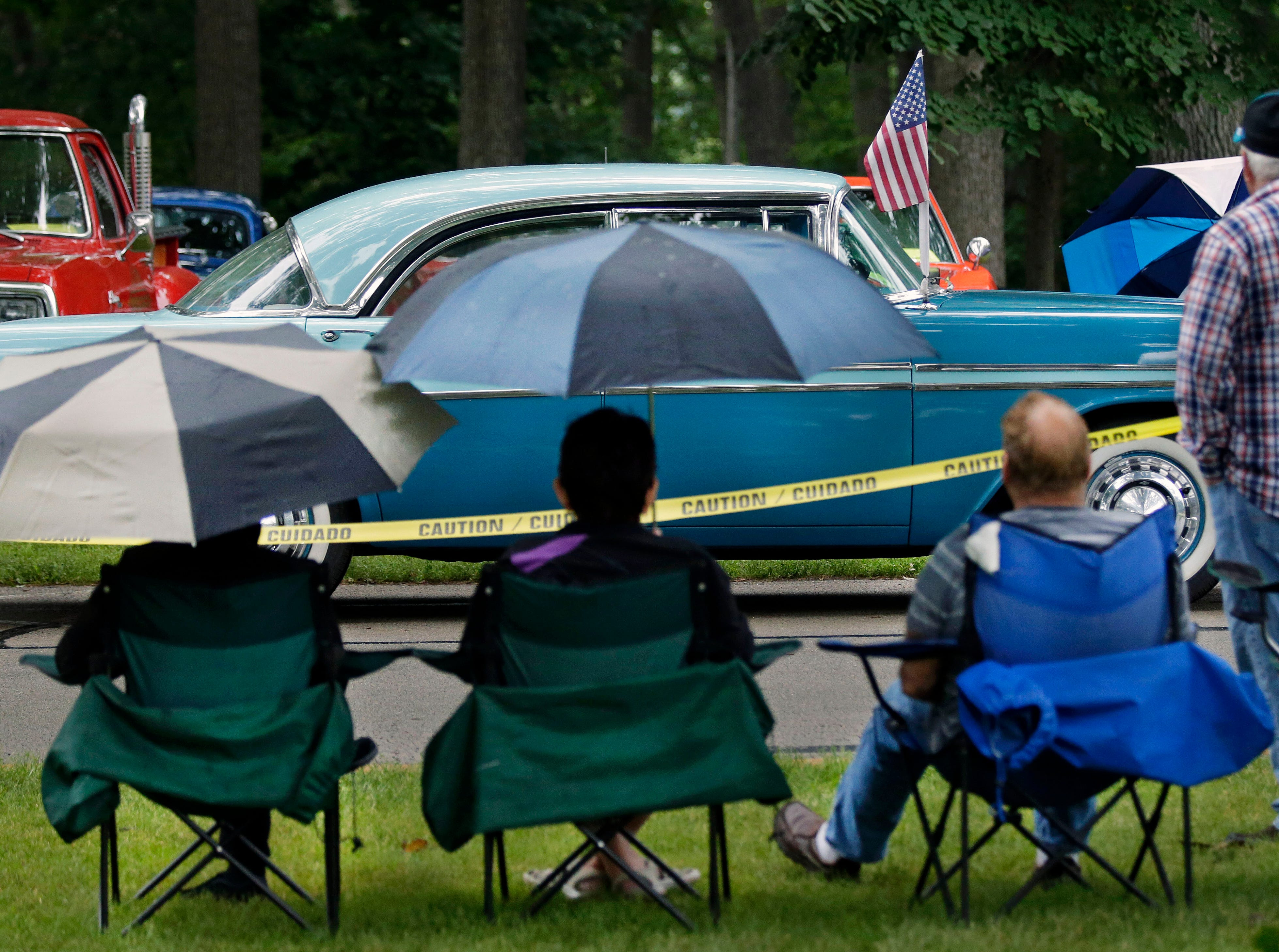 A Chevrolet Bel Air arrives while car fans look on as the Appleton Old Car Show and Swap Meet takes place Sunday, July 22, 2018, at Pierce Park in Appleton, Wis.