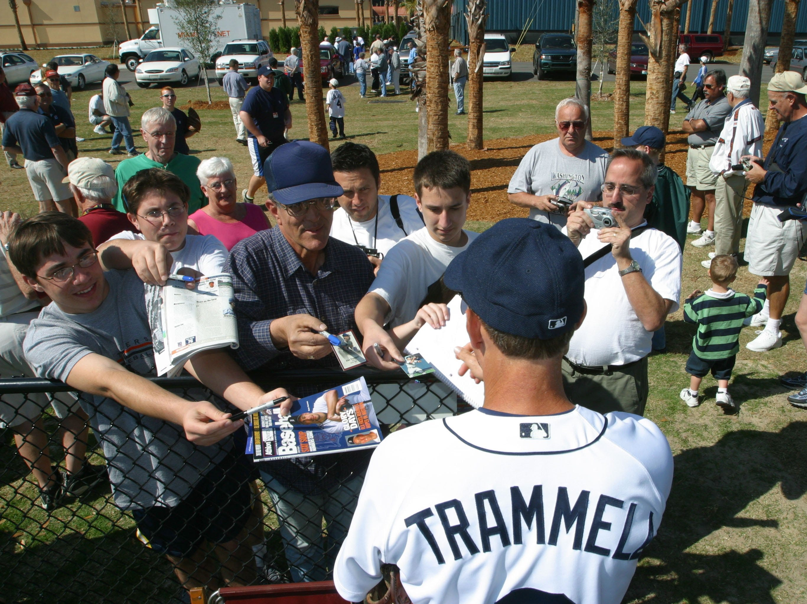 Detroit Tigers Manager Alan Trammell stops to sign  autographs before putting his team through their first full squad workout at spring training in Lakeland, FL on Tuesday, February 18, 2003.