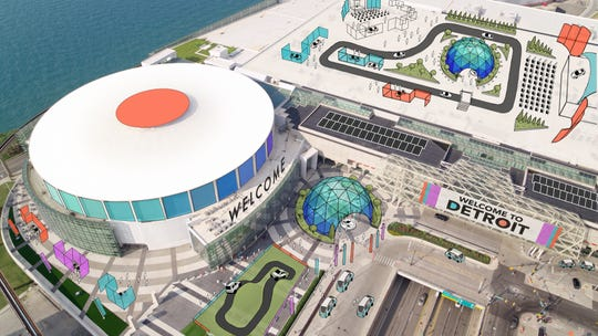 The Detroit auto show's expanded stage may include outdoor attractions like a test track on Cobo Center's rooftop parking lot.