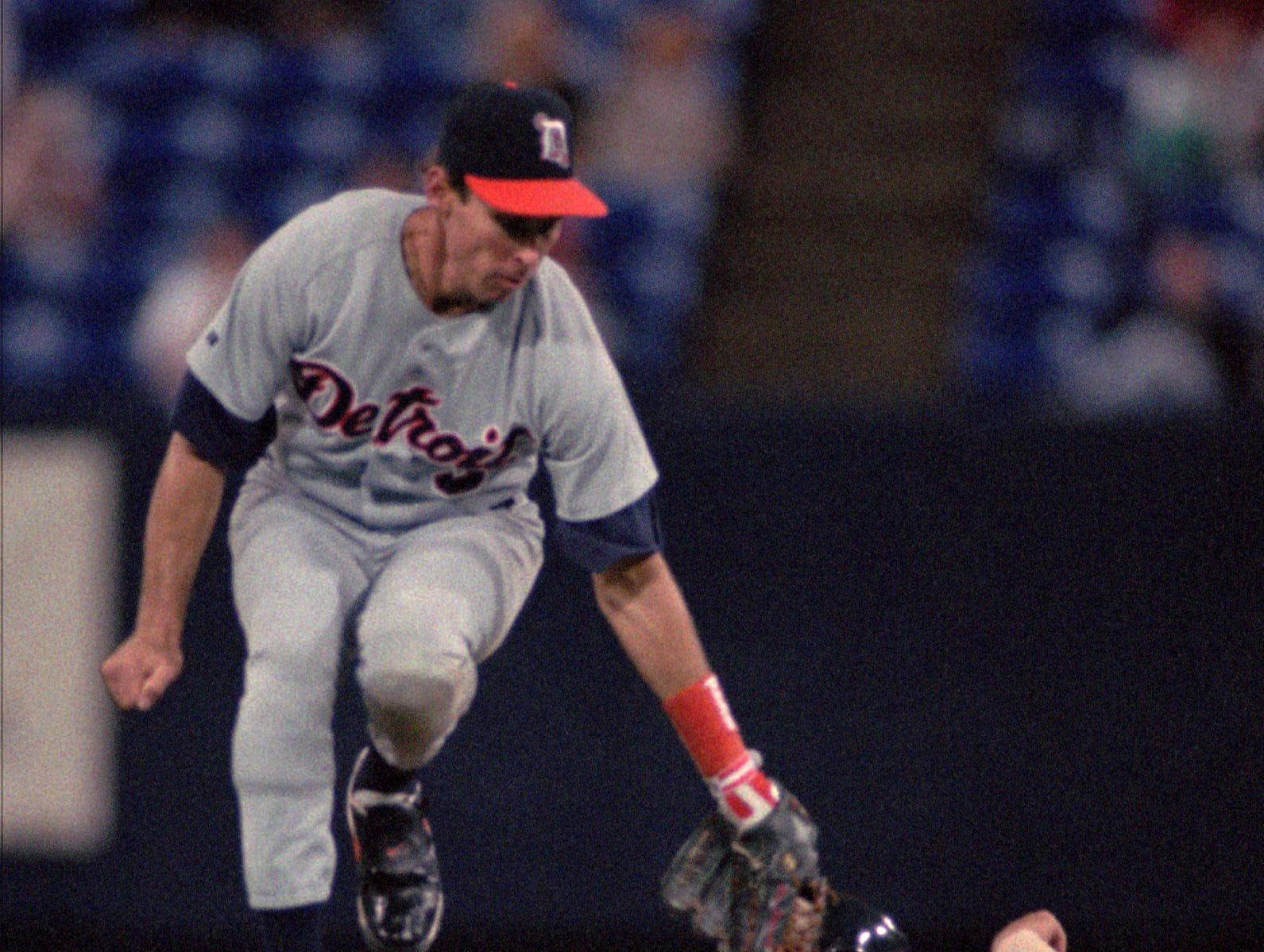 Detroit Tigers shortstop Alan Trammell goes airborne for a high throw from catcher Ron Tingley as Minnesota Twins' Scott Leius (31) steals second base in the second inning Thursday night, June 8, 1995, in Minneapolis.