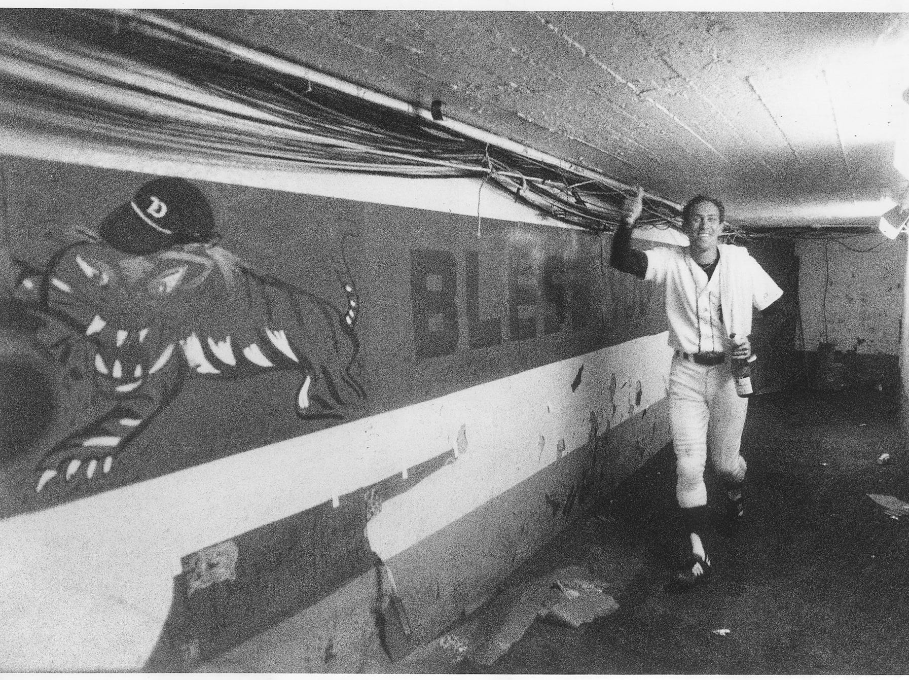 MVP Alan Trammell, carries a bottle left over from the Tigers' victory celebration following their World Series win in 1984.
