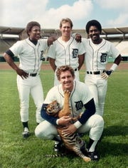 Detroit Tigers pose with Garfield, a baby tiger. Left to right is Lou Whitaker, Alan Trammell and Chet Lemon, with Lance Parrish kneeling during spring training in Florida 1984.
