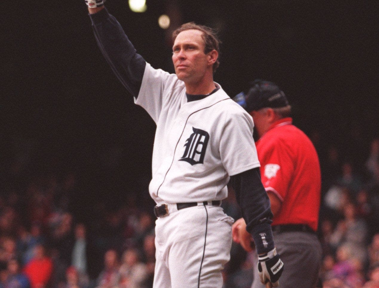 Detroit Tigers' Alan Trammell lifts his helmet to the crowd  against the Milwaukee Brewers on Sunday, Sept. 29, 1996, in Detroit. Trammell announced his retirement following the game. The Brewers beat the Tigers, 7-5.