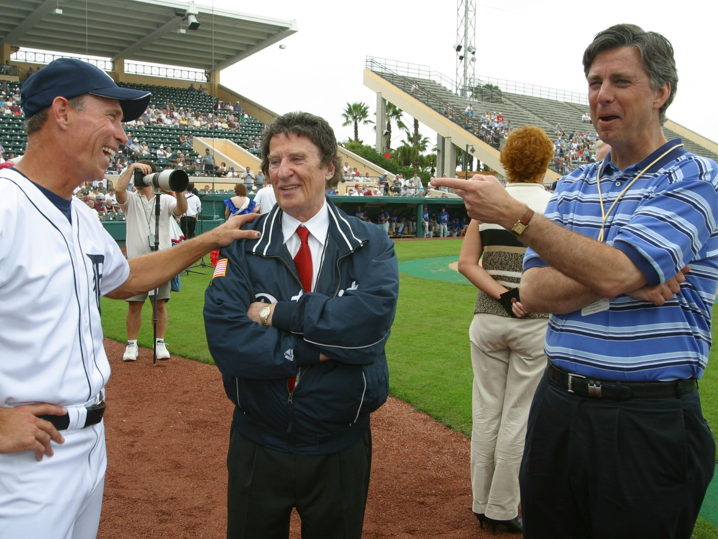 Detroit Tigers owner Mike Ilitch, center, chats with  Tigers  manager Alan Trammell , left, and Tigers President, CEO, and GM David Dombrowski, right,  prior to the Tigers &  LA Dodgers game at Jocker Marchant Stadium in Lakleand, Florida on Friday., February 28, 2003.