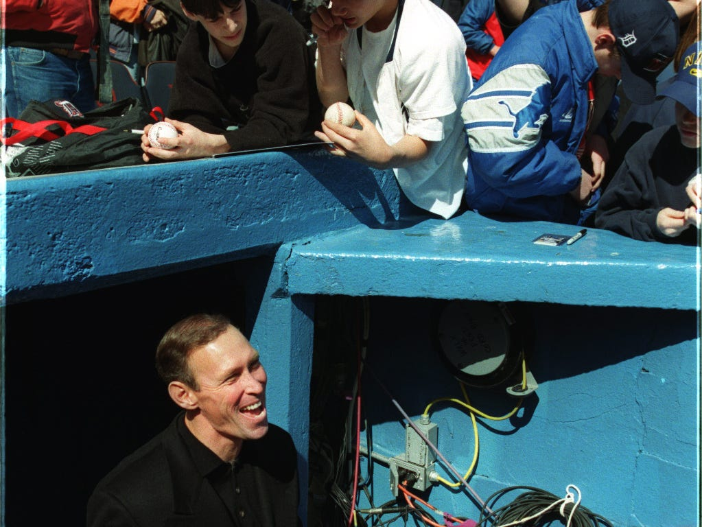 Former Detroit Tiger player Alan Trammell signs autographs before the start of the season opener against Tampa Bay on April, 7, 1998.