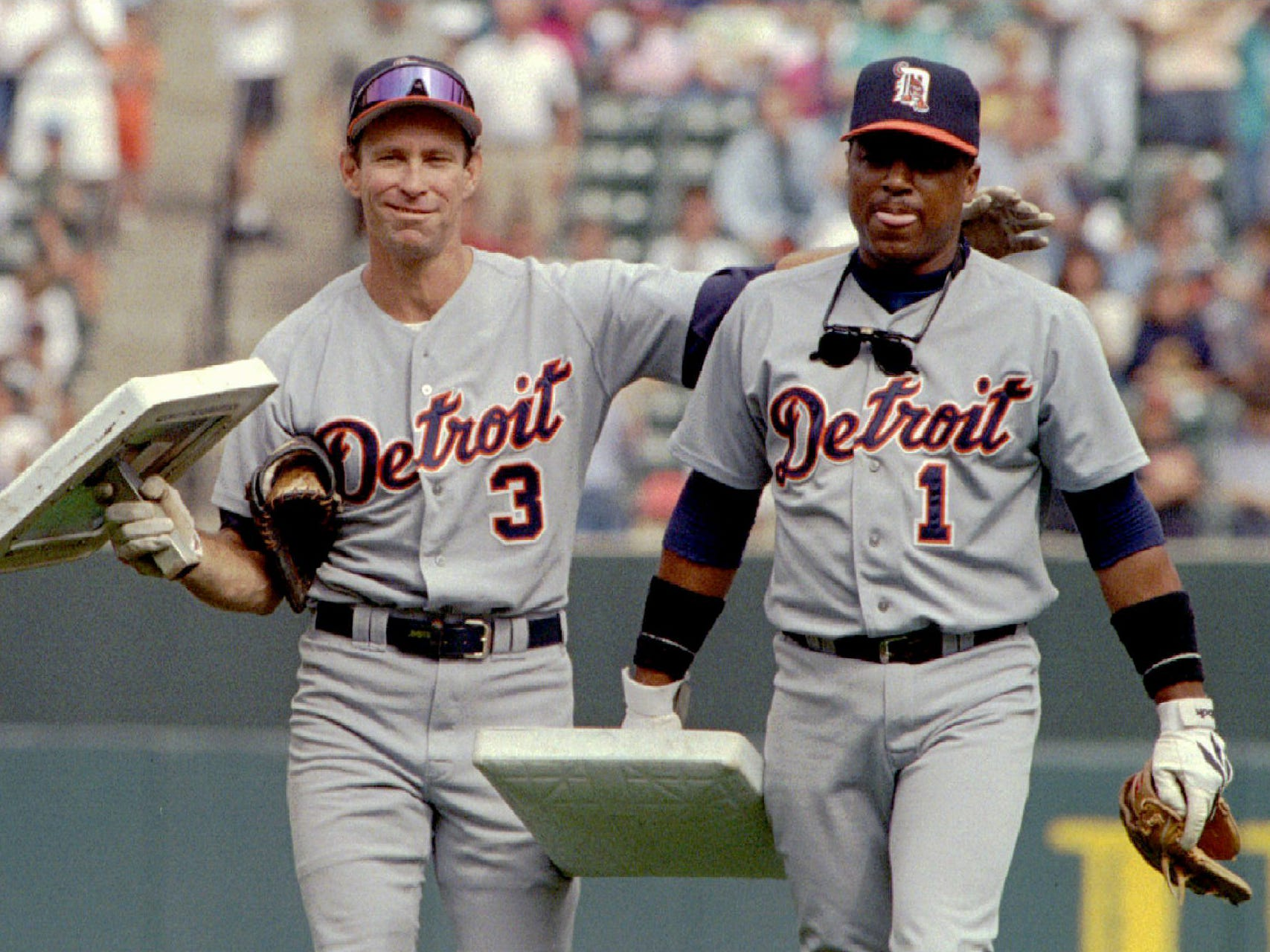 Detroit Tigers' Alan Trammell and a teammate Lou Whitaker walk off the field at Camden Yards with bases that were presented to them by Baltimore Orioles' Cal Ripken and Jeff Huson, October 1, 1995.