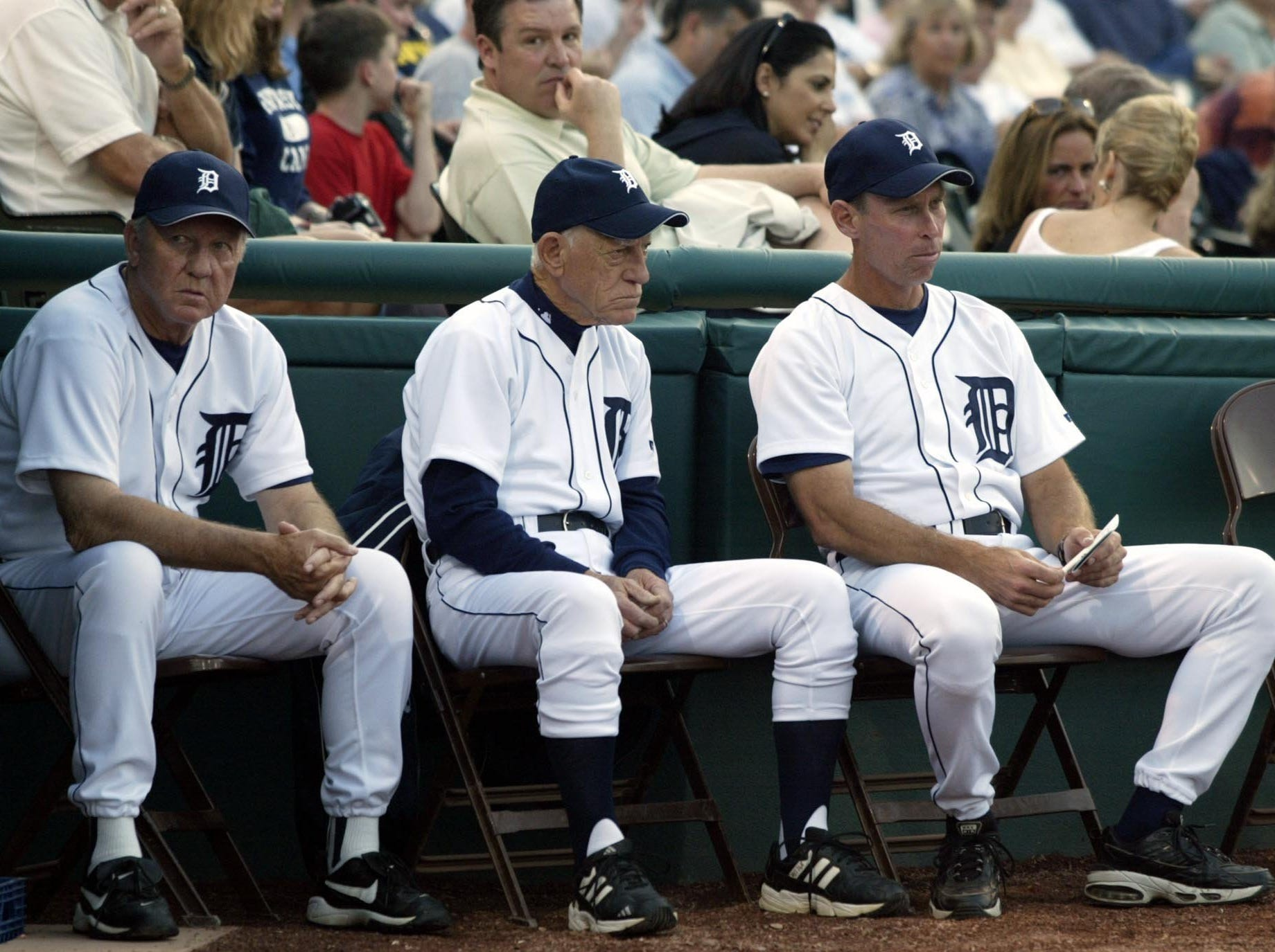 Former Detroit Tigers player Al Kaline, left, former manager Sparky Anderson, center, and current manager Alan Trammell, right, watch the start of the Tigers' game against the Montreal Expos in Lakeland, Fla., Friday, March 14, 2003.