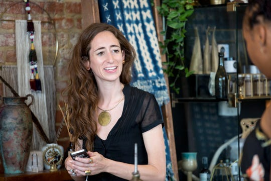 Erin Gavle, owner of Eldorado General Store in Corktown, chats with a customer at the store in Detroit on Sunday, July 22, 2018.