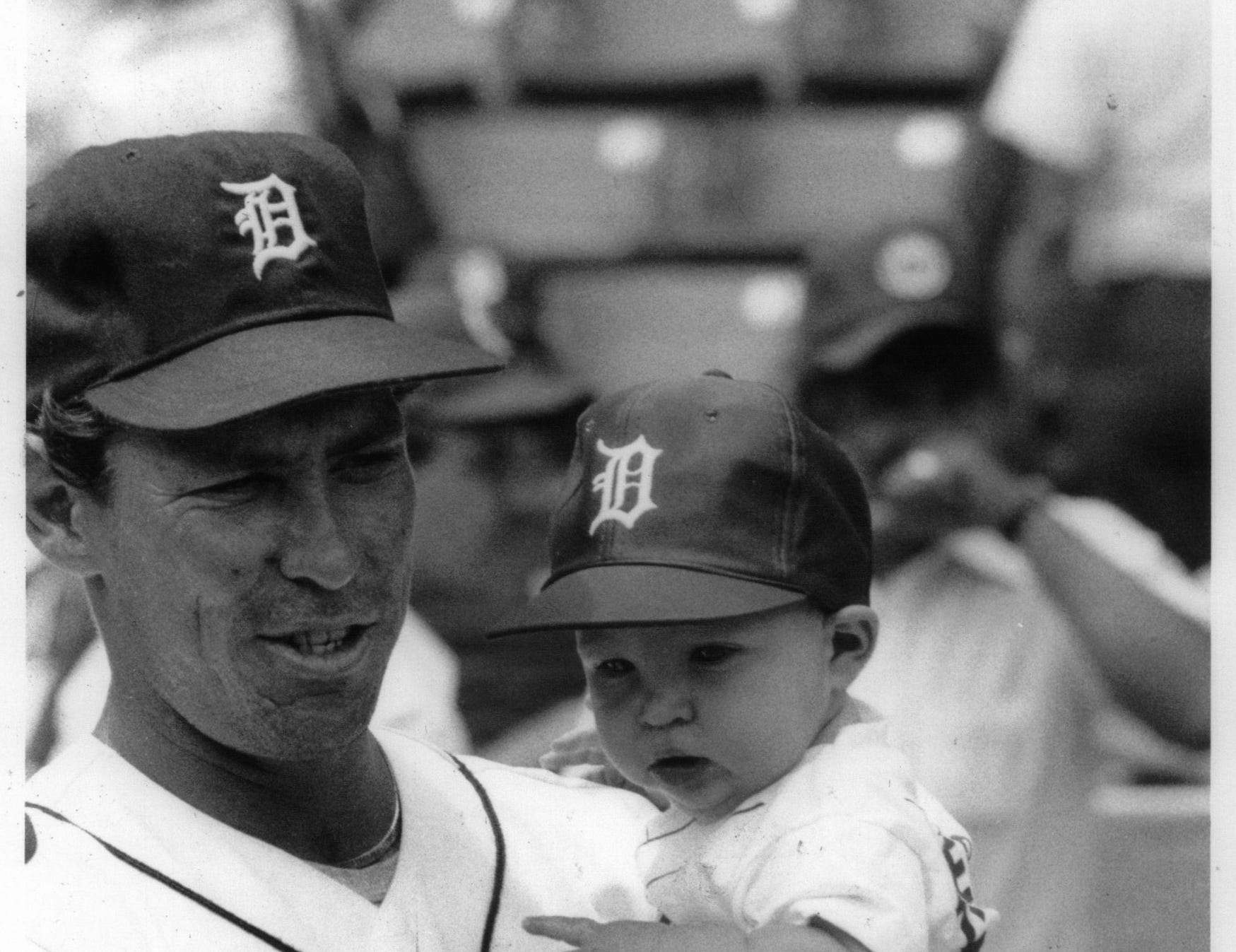 Alan Trammel holds son Kyle, who celebrated his sixth month as a Tiny Tiger on Saturday, June 24, 1884.