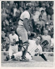 Alan Trammell slides into home plate.