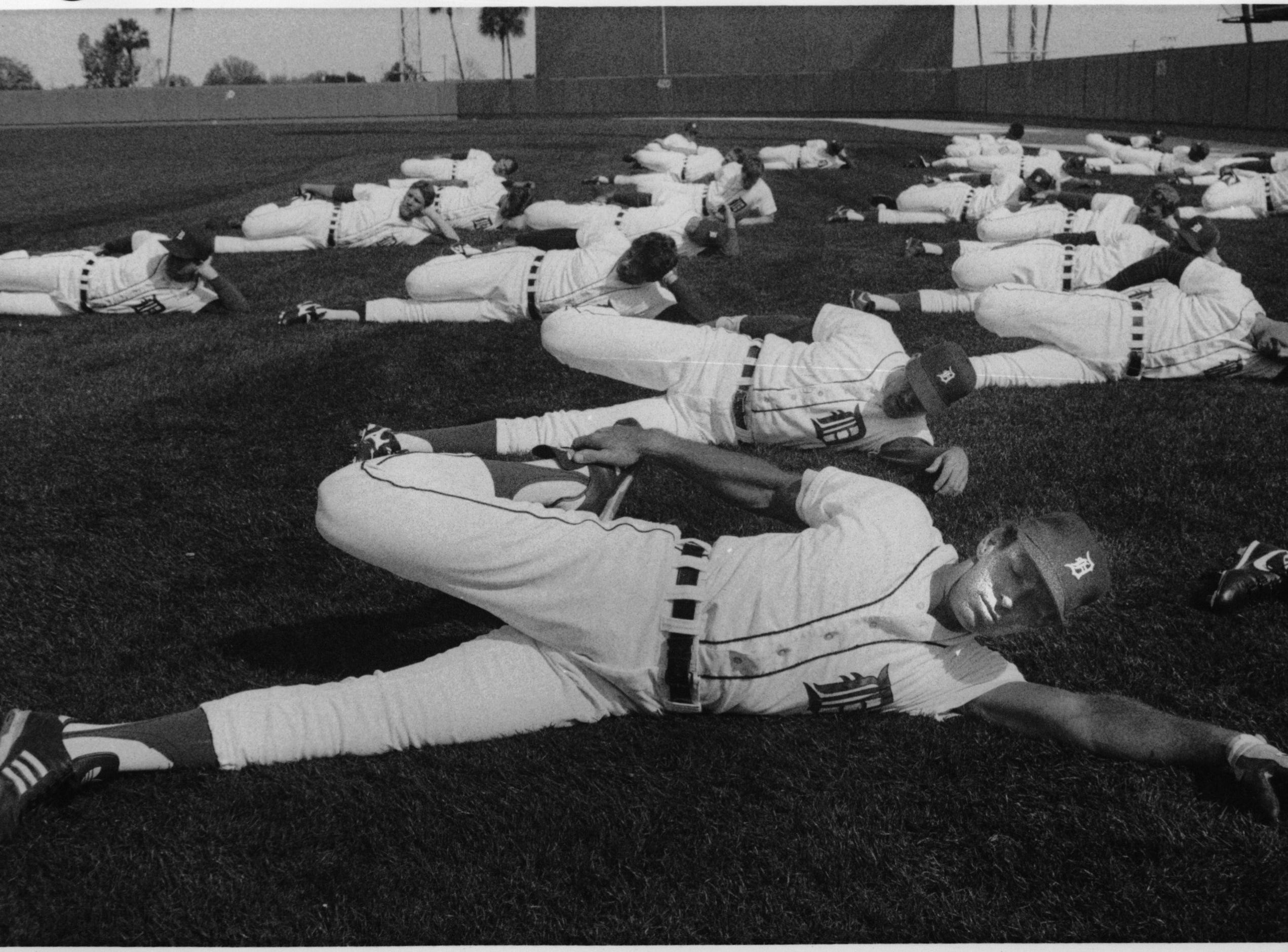 Alan Trammell stretches with teammates during a spring practice in February, 1988.