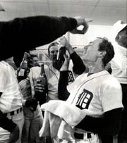 Alan Trammell and the Detroit Tigers celebrate in the locker room after winning the 1984 World Series.