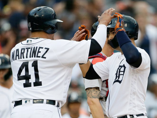 Jose Iglesias (1) of the Detroit Tigers celebrates with Victor Martinez (41) of the Detroit Tigers after hitting a two-run home run against the Boston Red Sox during the sixth inning.