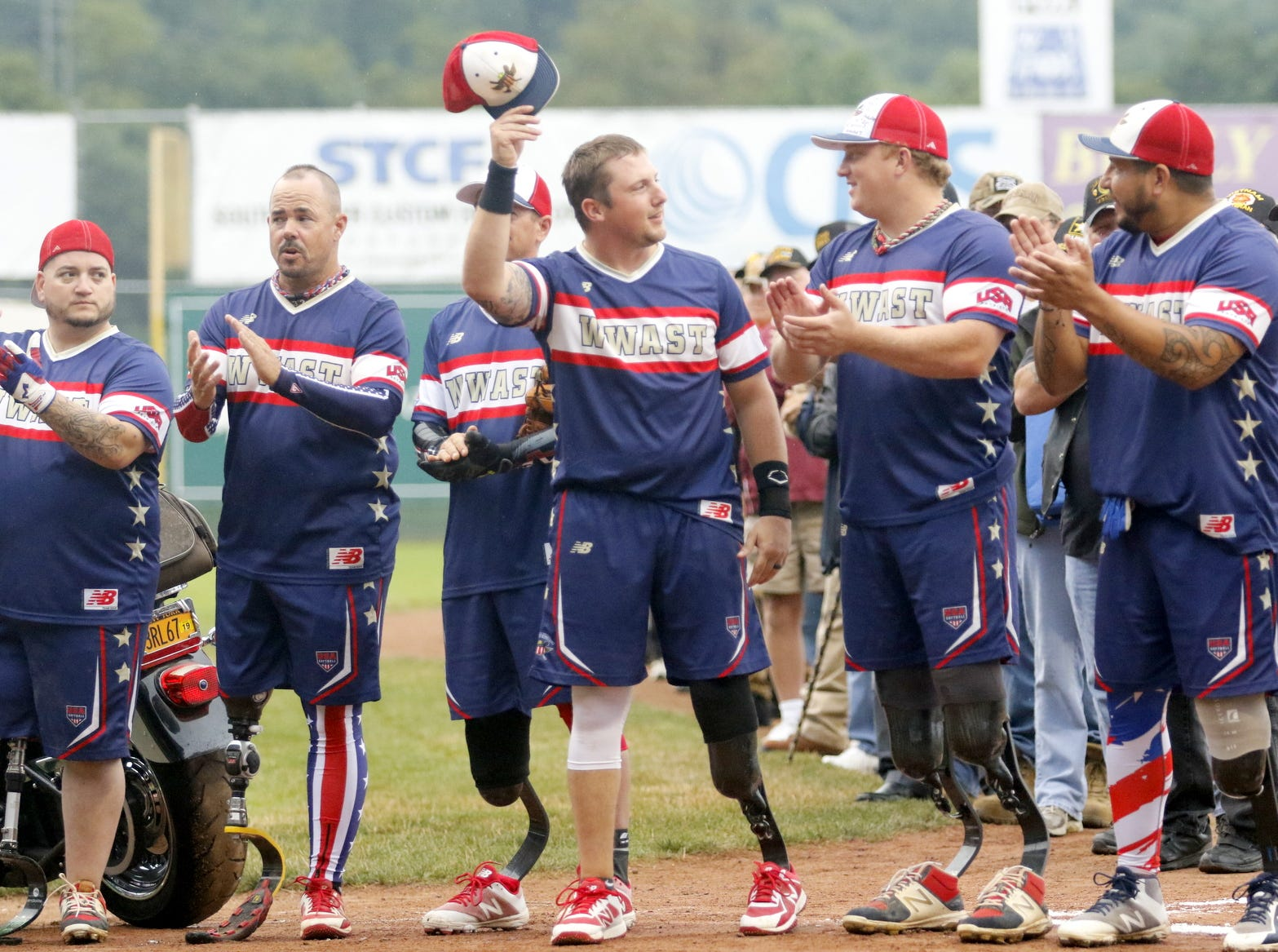 Brent Nadjadi of Bath is introduced for the Wounded Warrior Amputee Softball Team before its game against the Elmira Pioneers on July 21, 2018. WWAST was an 11-5 winner in the seven-inning softball game.