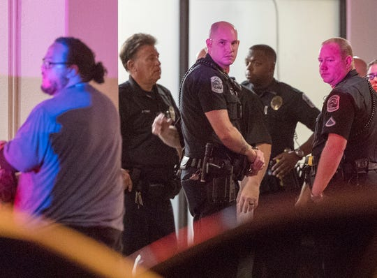 Fort Myers Police On Saturday, 21st Officers arrive in front of Lee Memorial Hospital on July 1, 2018, after a colleague was shot dead earlier that night.