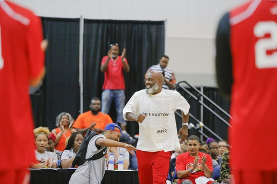 "Kevin ""Coach K"" Lee is introduced to the crowd at Saturday's celebrity basketball game as part of Indiana Black Expo Summer Celebration at the Indiana Convention Center."
