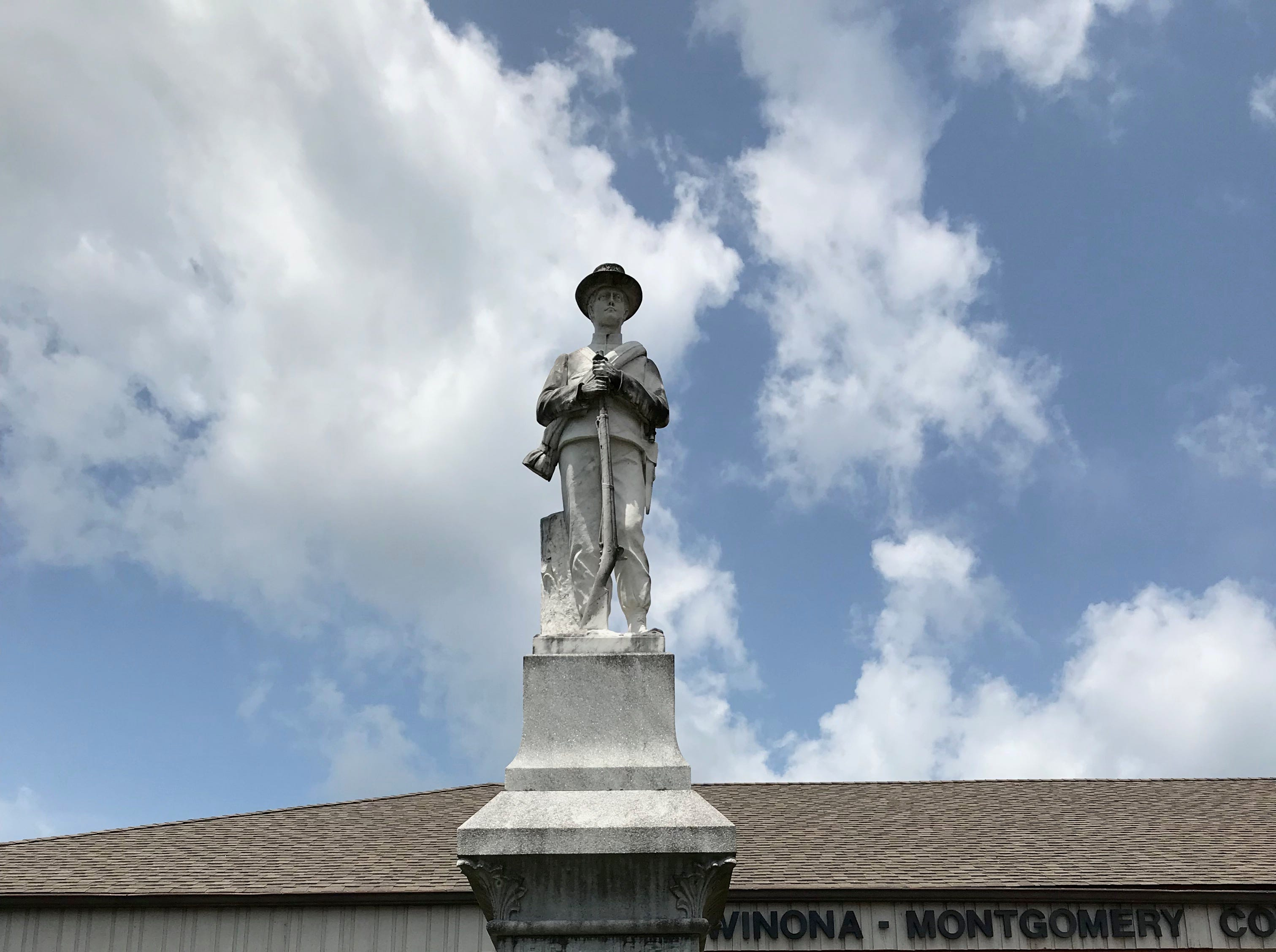 A confederate soldier memorial stands outside the town of Winona's library. The library was built on the site of the former courthouse. Thursday, July 19, 2018.