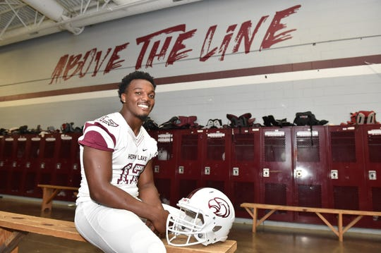 Nakobe Dean, one the highest rated players in Mississippi, sits in the locker room of Horn Lake High School.