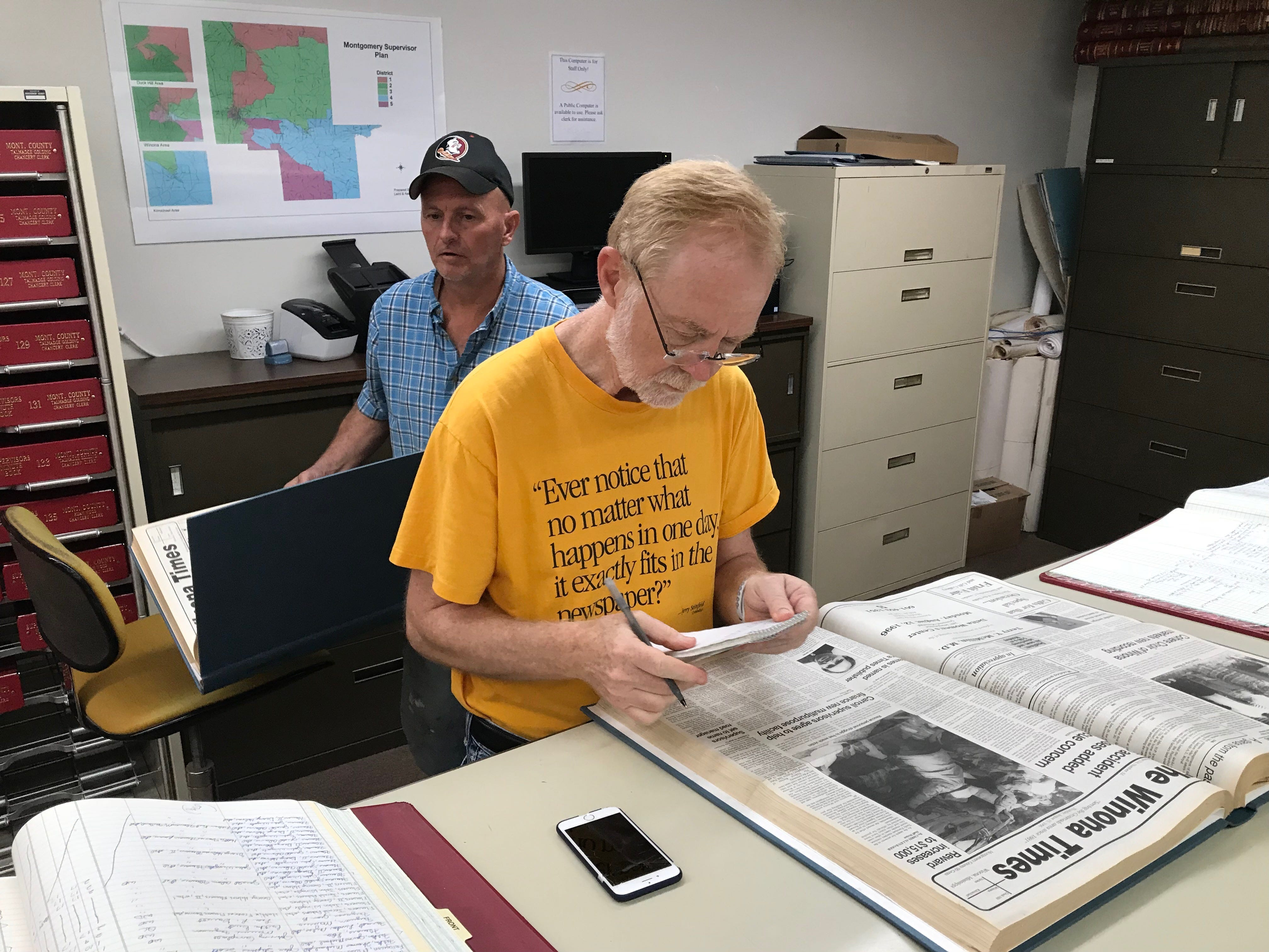 Jeffery Armstrong (left) and Clarion Ledger investigative reporter Jerry Mitchell (right) look through local records for The Winona Times publication at the Montgomery County Chancery Clerk's office. Jeffrey Armstrong found a .38 caliber gun outside his mother's former home close to the scene of the 1996 Tardy Furniture quadruple murders- the case for which Parchman Prison inmate Curtis Flowers and Winona local has been tried 6 times since 1996. Thursday, July 19, 2018.