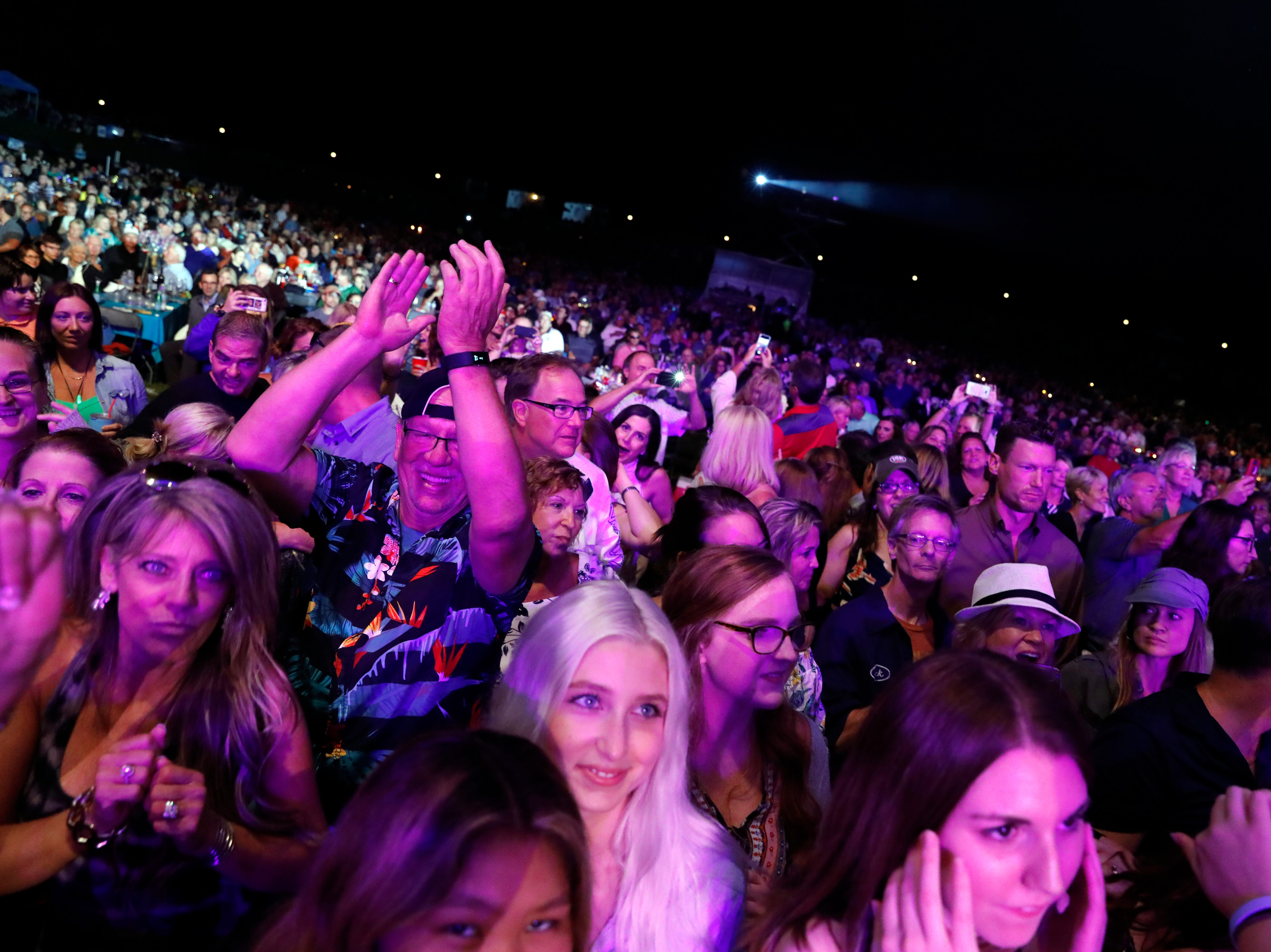 The crowd reacts as Dennis DeYoung performs Saturday night, July 21, 2018, at the Ohio University Lancaster Wendel Concert Stage in Lancaster.