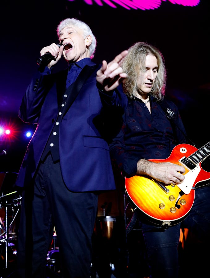 Dennis DeYoung sings as August Zadra plays guitar Saturday night, July 21, 2018, at the Ohio University Lancaster Wendel Concert Stage in Lancaster. DeYoung performed classic songs from the band Styx to a crowd of thousands that waited in the rain for the 2018 Lancaster Festival's first headline concert.