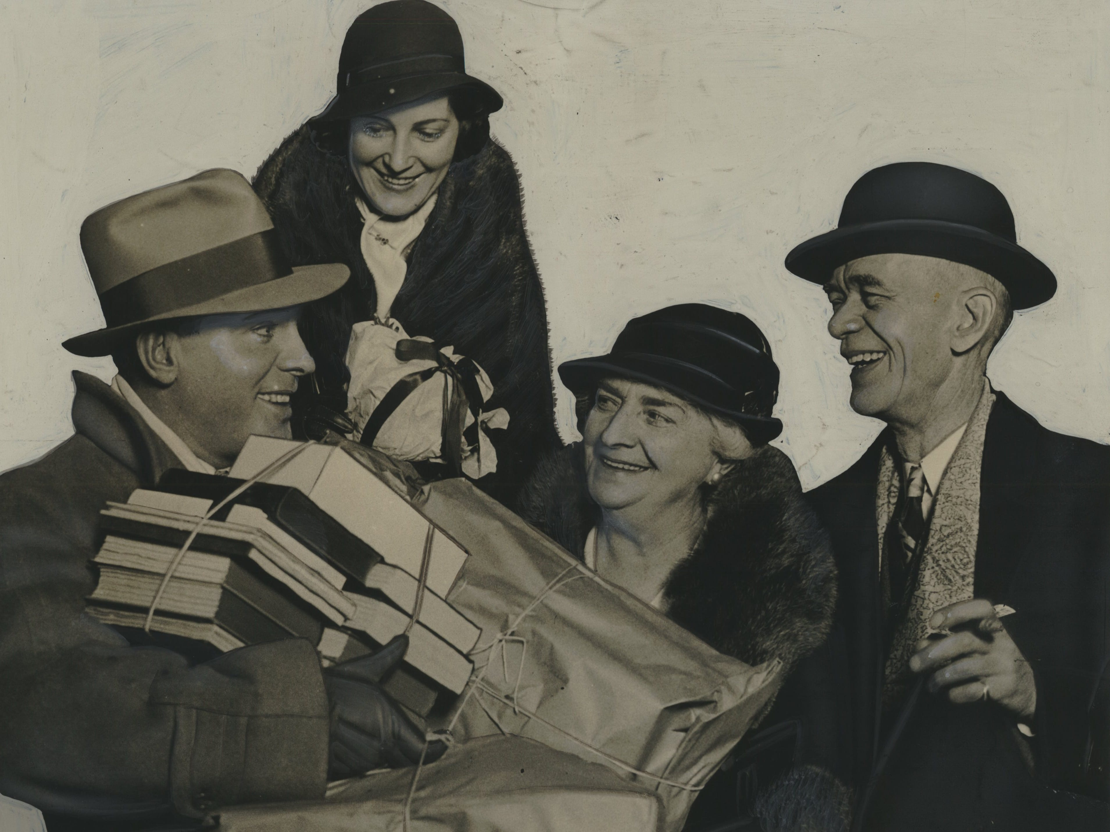 Stage actor turned Hollywood star Pat O'Brien comes home to Milwaukee with his wife, Eloise Taylor, bearing Christmas presents (right) for his parents on Dec. 24, 1932. This slightly altered photo was published in the Dec. 25, 1932, Milwaukee Journal, noting the actor and his wife were spending Christmas with his parents at their house at 1041 N. 14th St.
