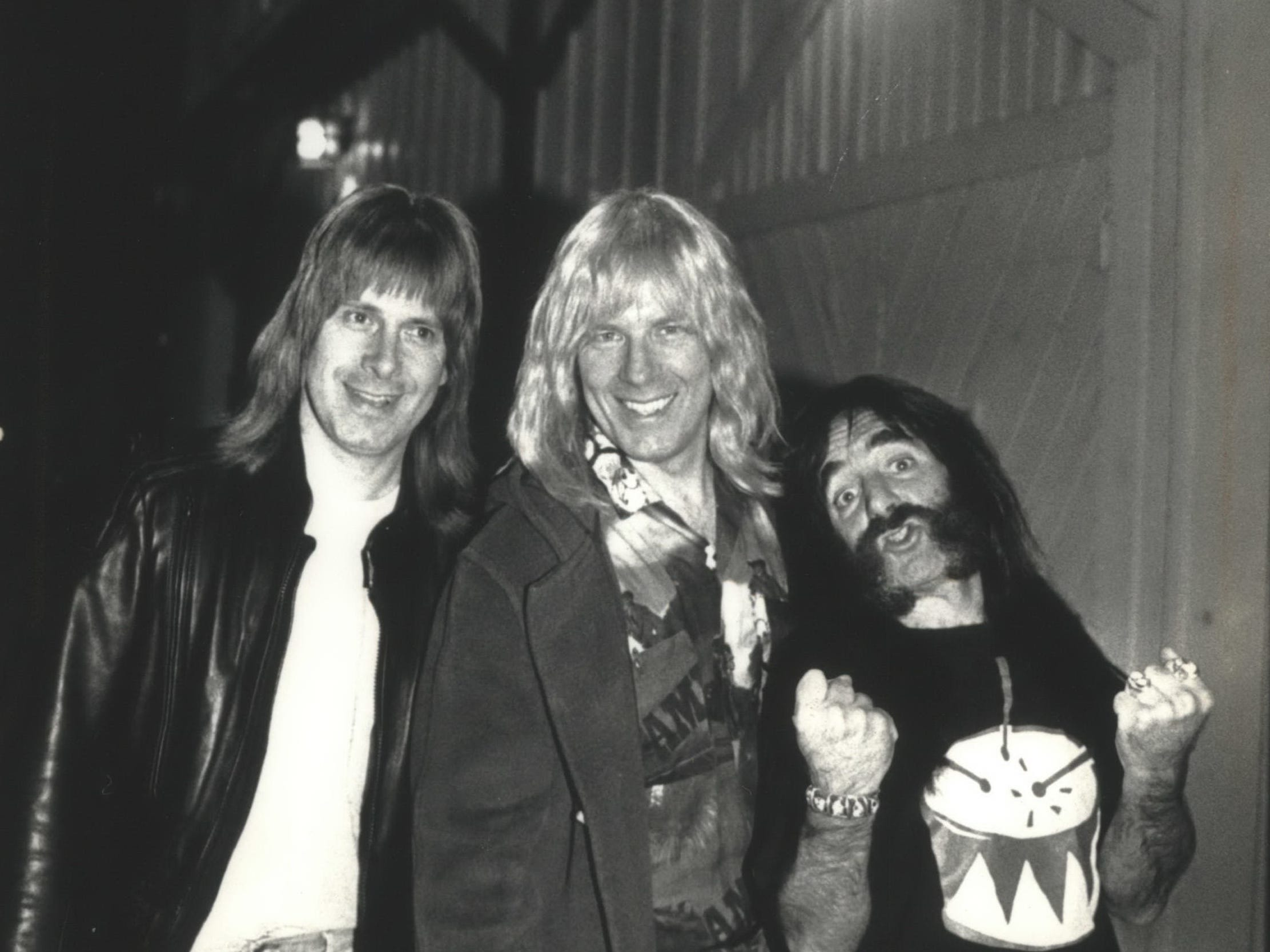 "Christopher Guest (from left), Michael McKean and Harry Shearer - a.k.a Nigel Tufnel, David St. Hubbins and Derek Smalls, of the fictional band Spinal Tap - hang around outside Shank Hall on May 20, 1992. Opened at 1434 N. Farwell Ave. in 1989, Shank Hall took its name from a fictional Milwaukee venue that hosted a particularly disastrous concert in the 1984 mockumentary ""This Is Spinal Tap."" This photo was published in the May 21, 1992, Milwaukee Journal."