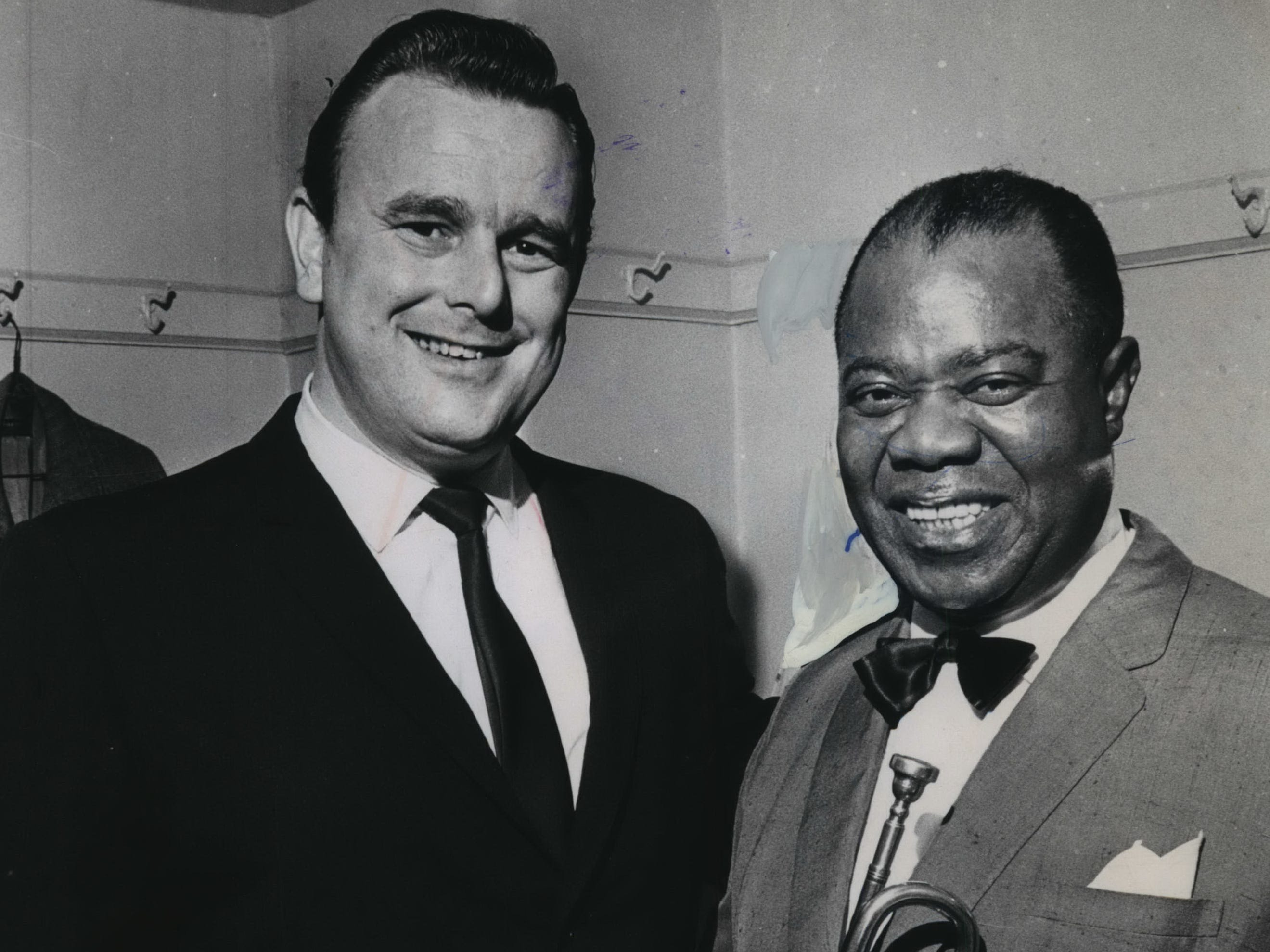 Louis Armstrong (right) pose with Bob Knudsen backstage at the Milwaukee Auditorium in 1964.