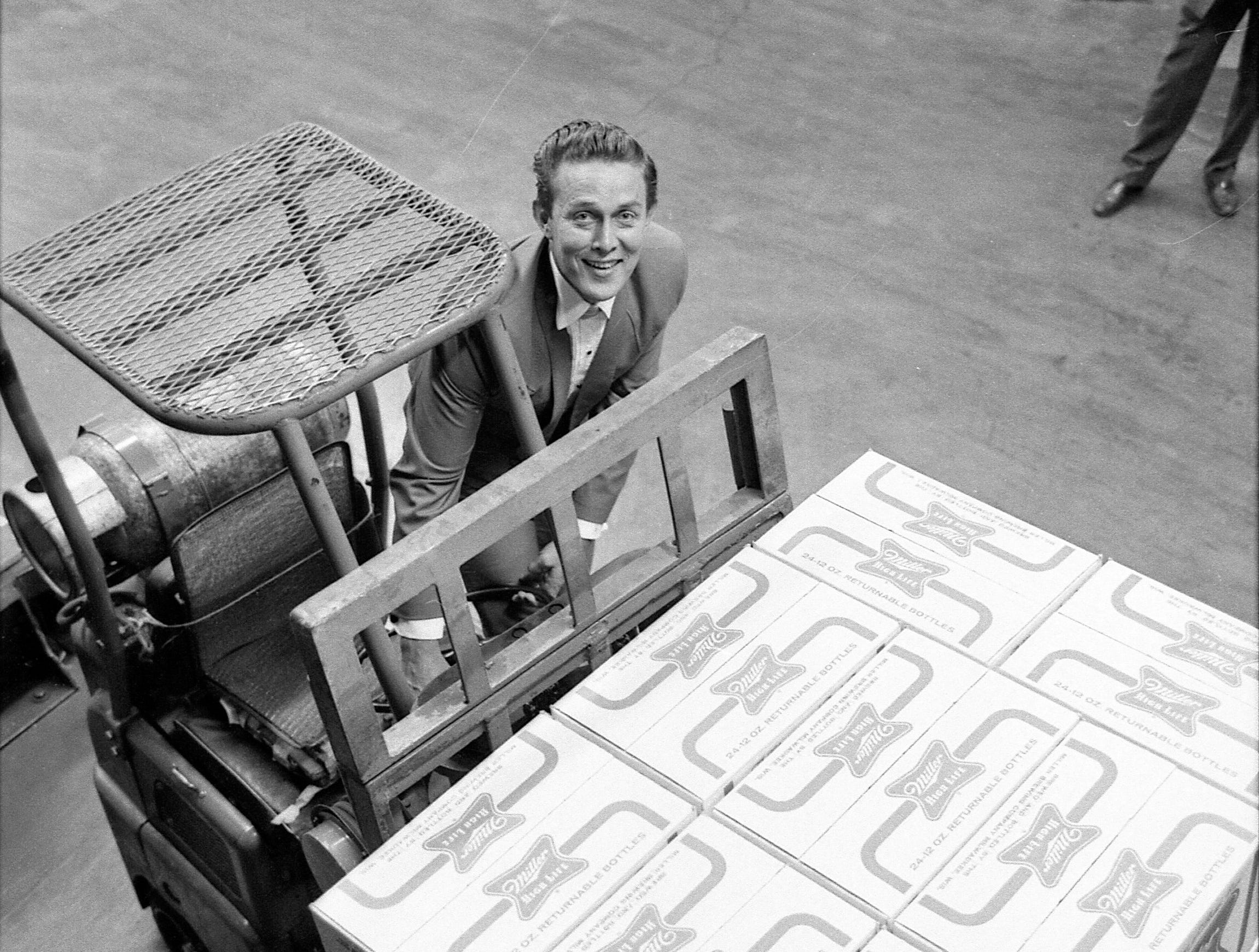 "Singer, TV star and sausage king Jimmy Dean gets behind the wheel of a forklift at Miller Brewing Co. on Aug. 23, 1965. Miller was a co-sponsor of ""The Jimmy Dean Show"" on ABC."