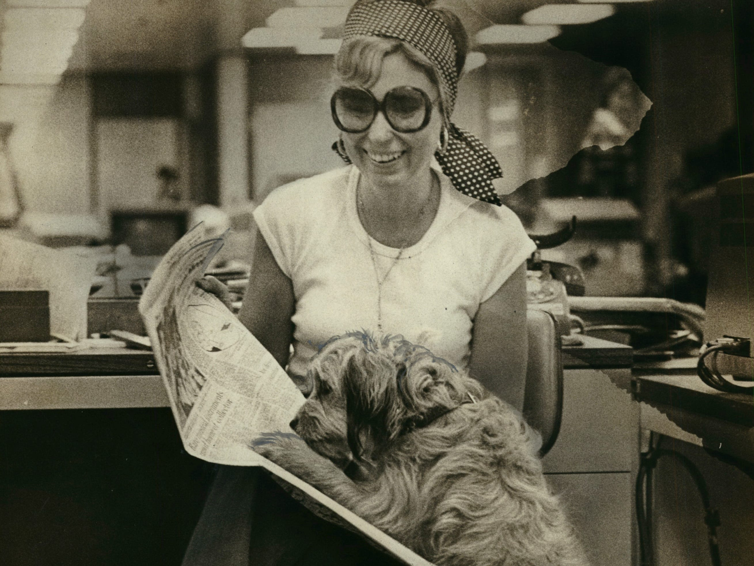 "Benji, probably Hollywood's most lovable actor, reads the Green Sheet with help from her interviewer, Milwaukee Journal reporter Mary Fran Cahill, during a visit to the Milwaukee Journal's office during the summer of 1977. This photo was published in the June 29, 1977, Milwaukee Journal. For more on Benji's ""interview,"" go to http://archive.jsonline.com/greensheet/benji-visits-the-green-sheet--in-1977-b99646505z1-364454951.html."