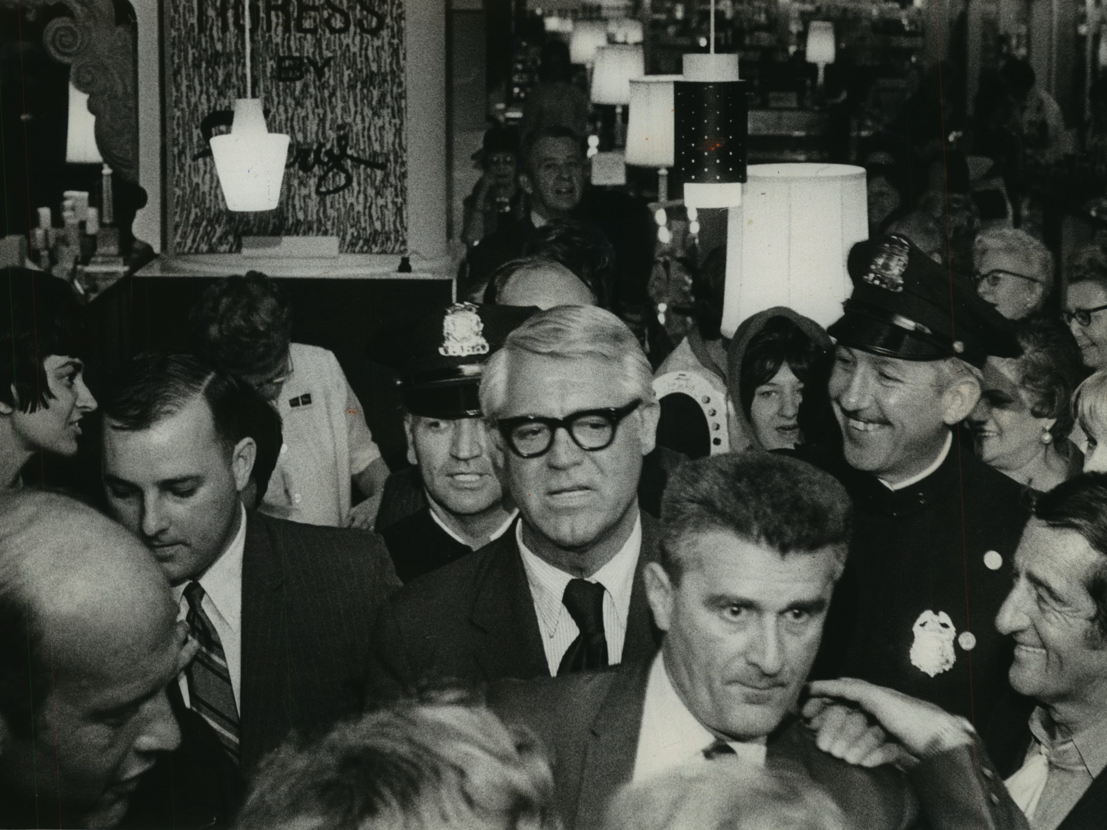 Cary Grant makes his way through the crowd he attracted during a promotional stop at Boston Store on N. 4th St. and W. Wisconsin Ave. on Oct. 1, 1969. Grant was appearing on behalf of Faberge; the actor was on the perfume-maker 's board of directors at the time. This photo was published in the Oct. 2, 1969, Milwaukee Journal.