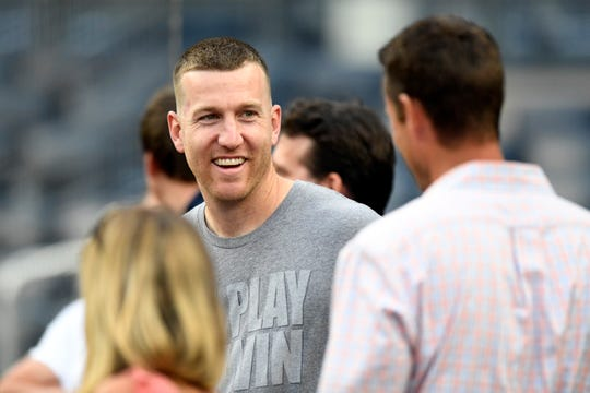 New York Mets third baseman Todd Frazier talks to fans during batting practice. The New York Mets and the New York Yankees face off for the final game of the Subway Series in the Bronx on Sunday, July 22, 2018.