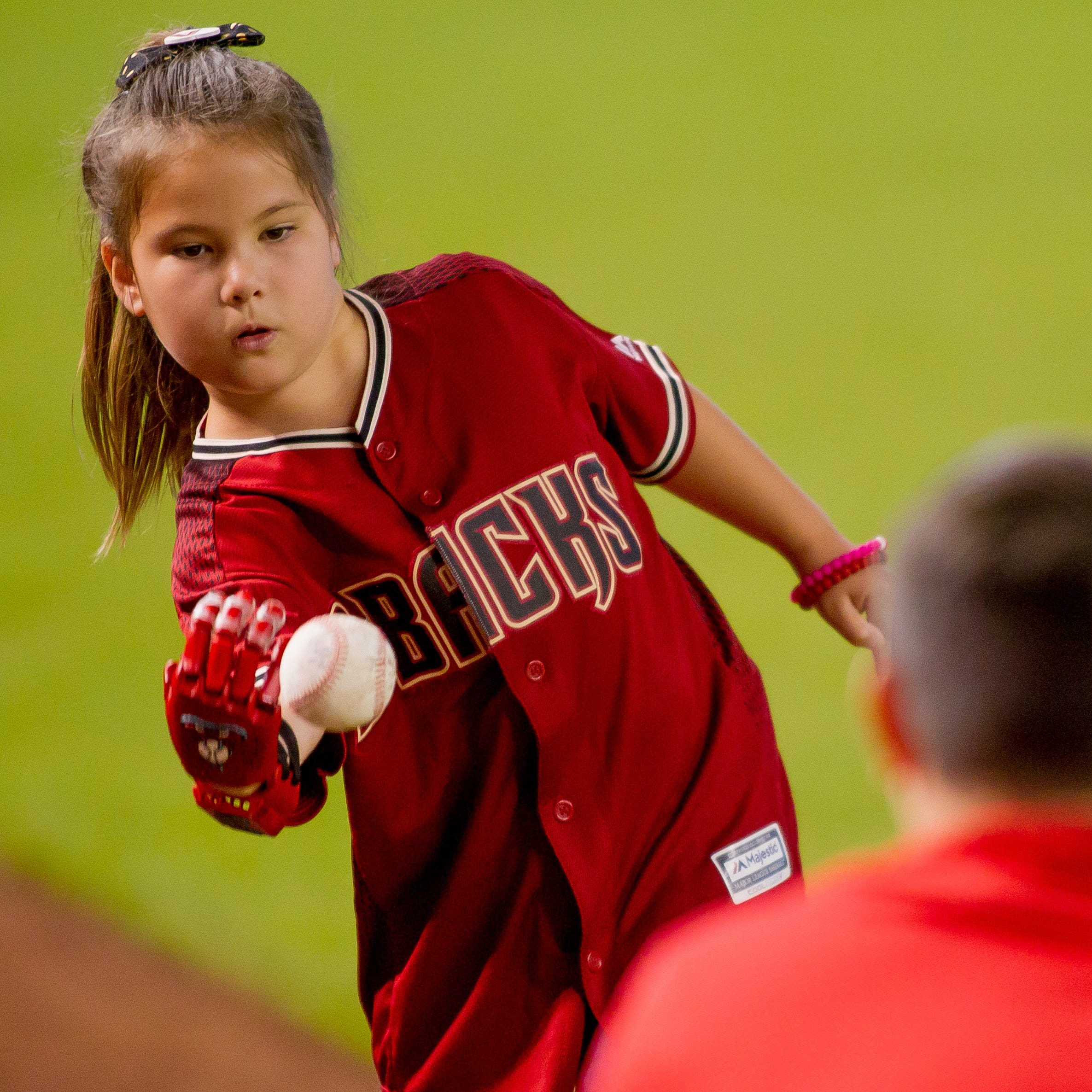 A new hand, a new ballpark: Girl throws first pitch at D-Backs game with 3D-printed hand