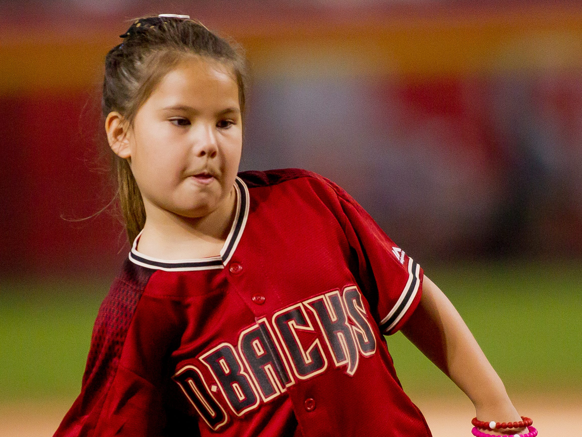 Hailey Dawson, 8, of Henderson, Nevada, throws the ceremonial first pitch on July 21, 2018, before the Arizona Diamondbacks' matchup against the Colorado Rockies at Chase Field in Phoenix, Arizona. Hailey, born with Poland Syndrome, received a 3D-printed prosthetic hand created by engineering students from the University of Nevada Las Vegas.