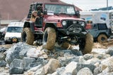 Watch Jeeps navigating obstacle course during  23rd Annual PA Jeeps All Breeds Jeep Show  at the York Expo Center