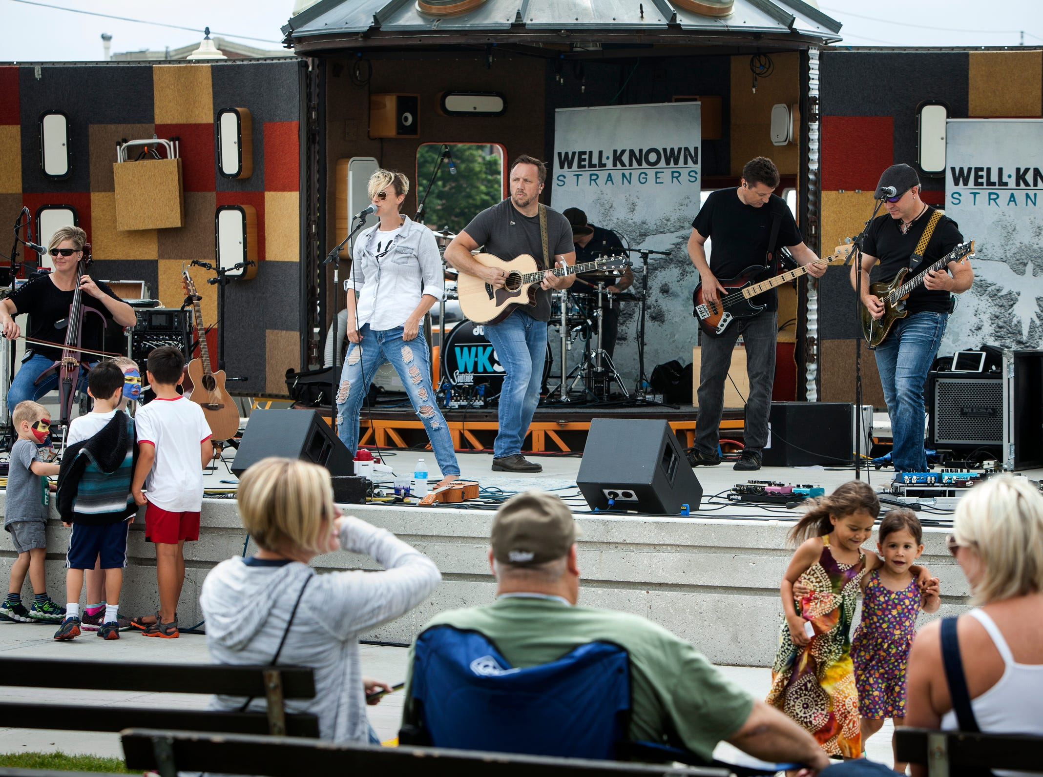 Music by Well - Known Strangers at Midsummer Festival of the Arts in Sheboygan on July 21.