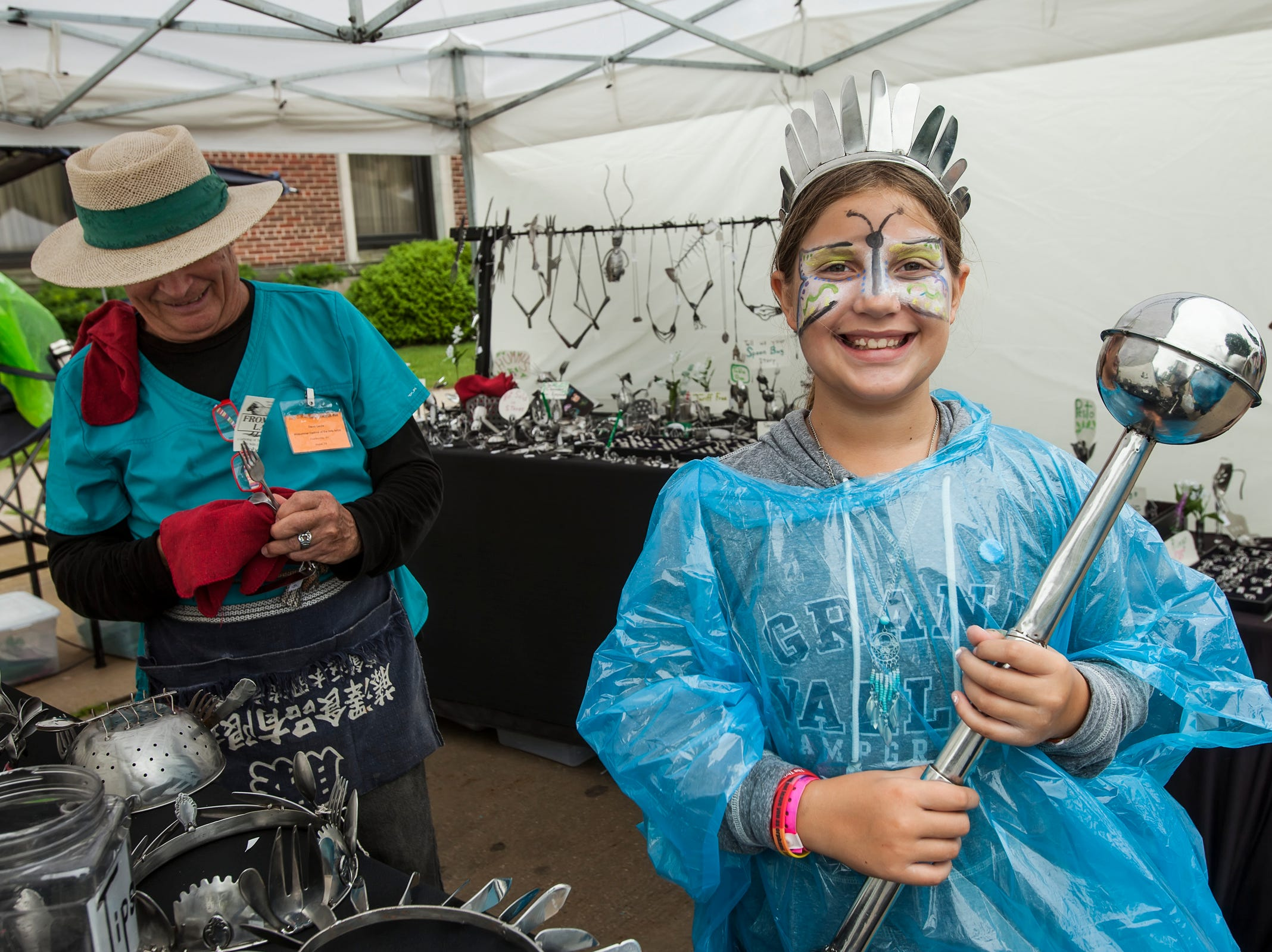 Alaina Neitel, 10, of Plymouth models a crown and wand from the Spoon Bug at the Midsummer Festival of the Arts in Sheboygan on July 21.