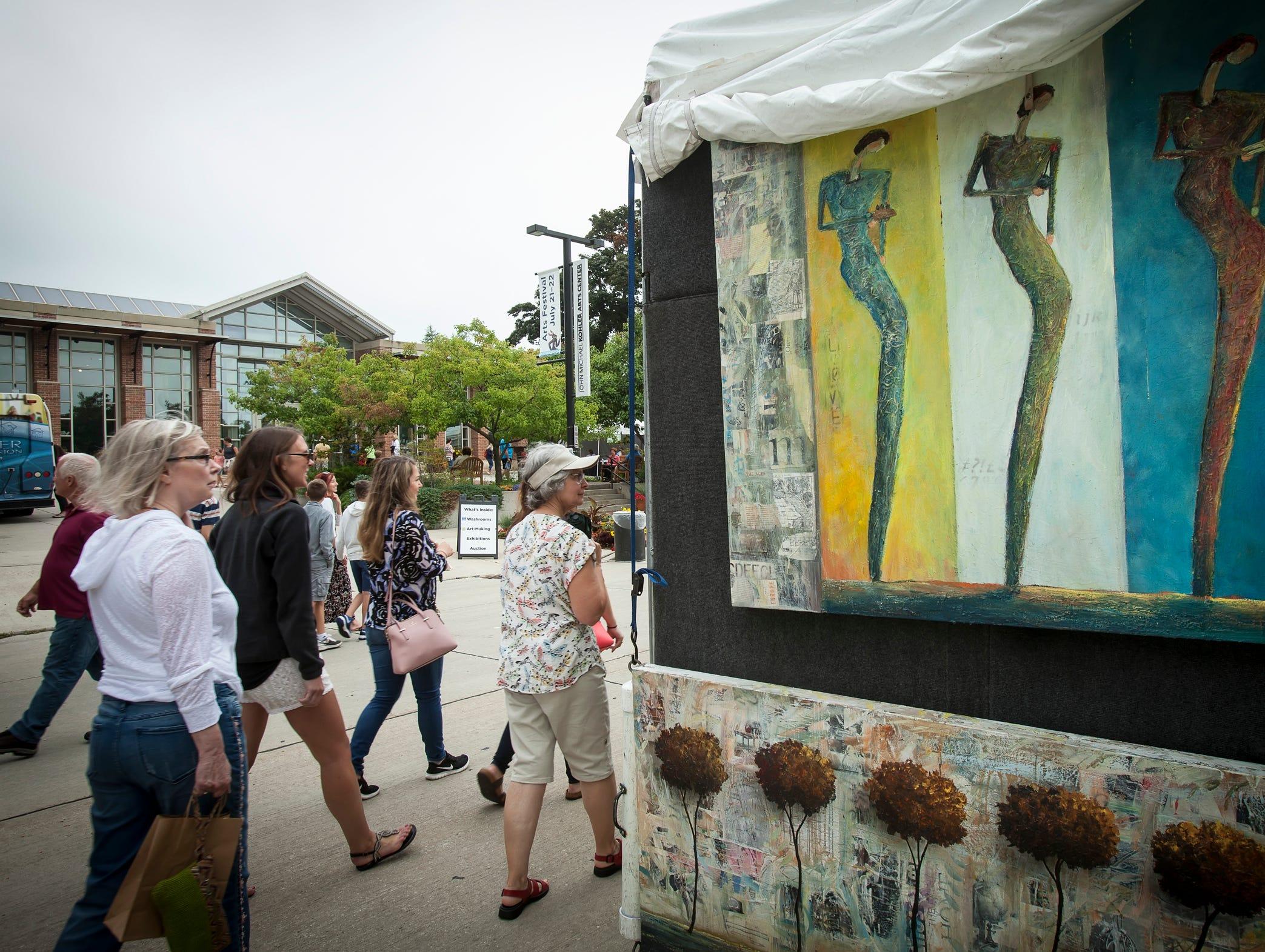 Scenes from the Midsummer Festival of the Arts outside the John Michael Kohler Arts Center in Sheboygan on July 21.