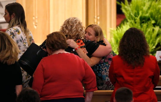 Family of victims of the duck boat accident on Table Rock Lake embrace after a community wide memorial service for the families, friends and victims at College of the Ozarks in Point Lookout, Missouri on Sunday, July 22, 2018.