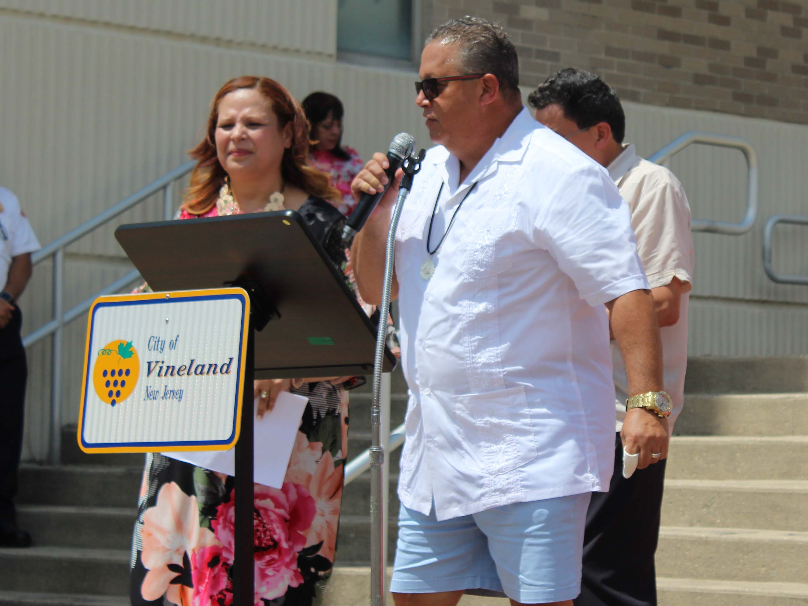 William Gonzalez, Executive Director of the Cumberland County Habitat for Humanity, gives an acceptance speech after receiving an award for his community service during the start of the Puerto Rican Festival in Vineland on Sunday, July 22, 2018.