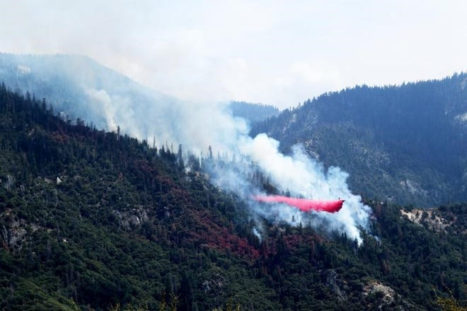 An air tanker makes a targeted retardant drop on the Horse Creek Fire in Sequoia National Park.