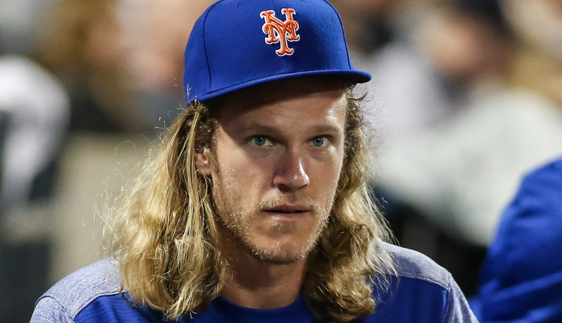 Noah Syndergaard watches the action at Citi Field.
