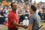 Tiger Woods held the outright lead at one point on Sunday but Italian Francesco Molinari prevailed, securing the victory at the Open Championship.