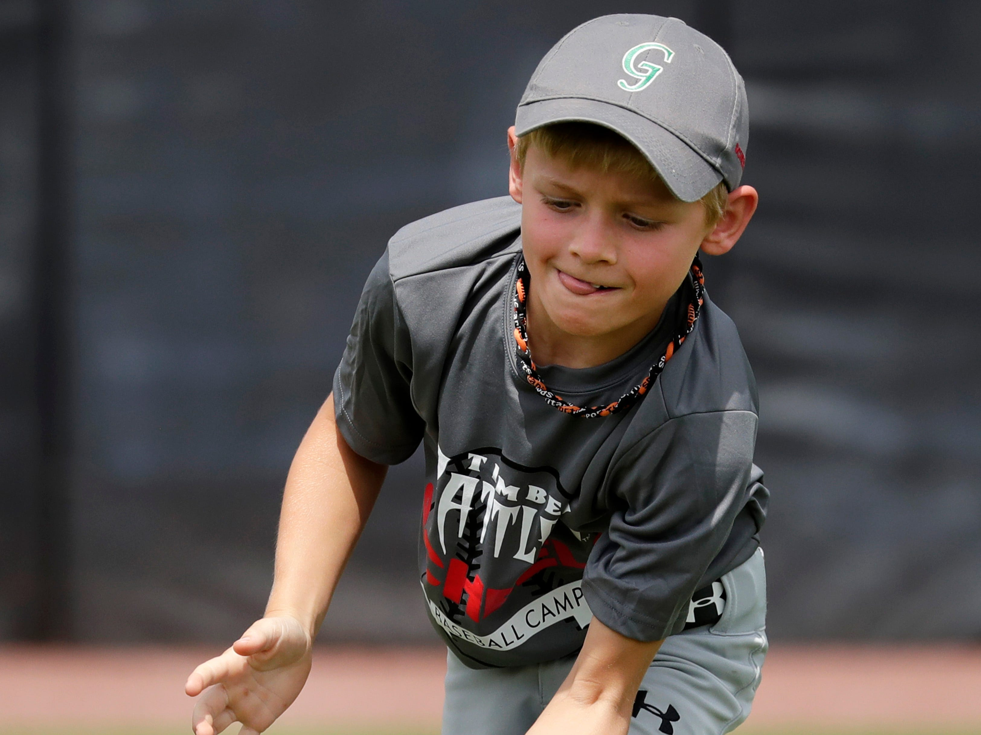 Jaxson Sroka, 9, makes a catch during the Scheels Kids Camp with the Wisconsin Timber Rattlers Thursday, July 19, 2018, at Neuroscience Group Field at Fox Cities Stadium in Grand Chute, Wis. 