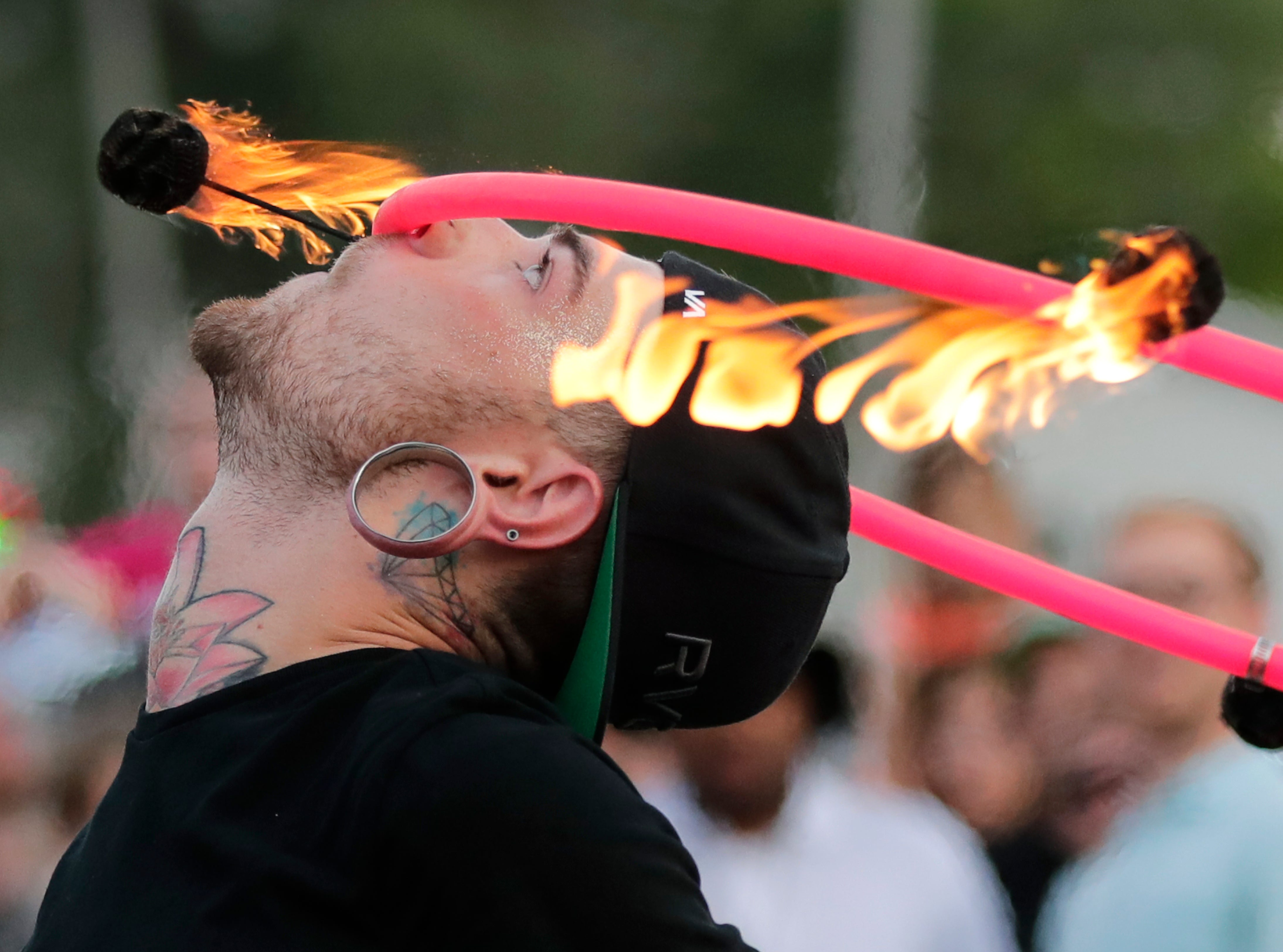 Casey Gottlieb of Appletonduring Bazaar After Dark Thursday, July 19, 2018, in Neenah, Wis. The event is hosted Pulse Young Professionals Network at the Fox Cities Chamber. Gottlieb is a crew member of Fox Valley Fire and Flow Collective.