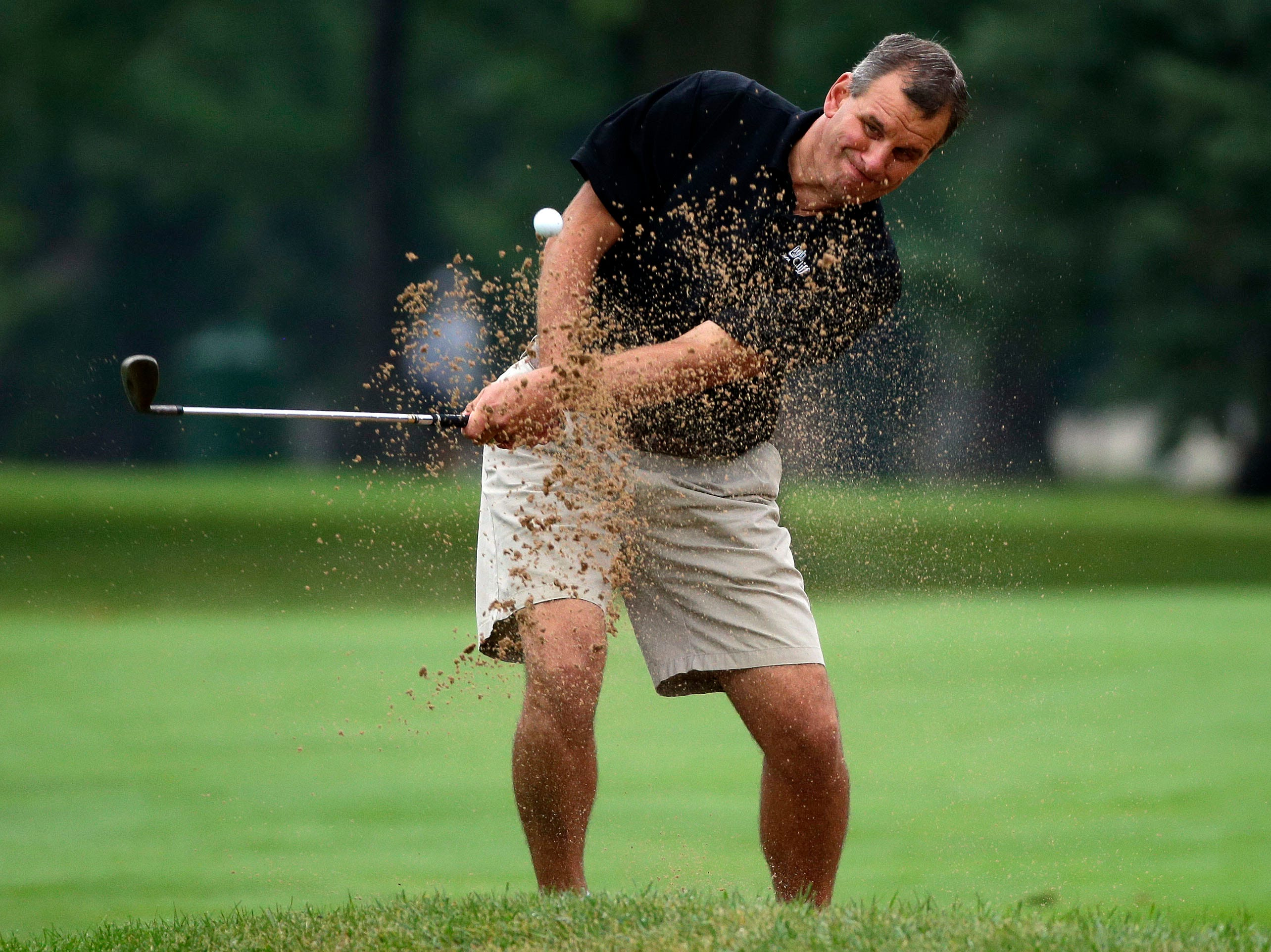 Mike Schlaak hits out of the sand as the final round of the Fox Cities Amateur golf tournament Sunday, July 22, 2018, at Reid Golf Course in Appleton, Wis.