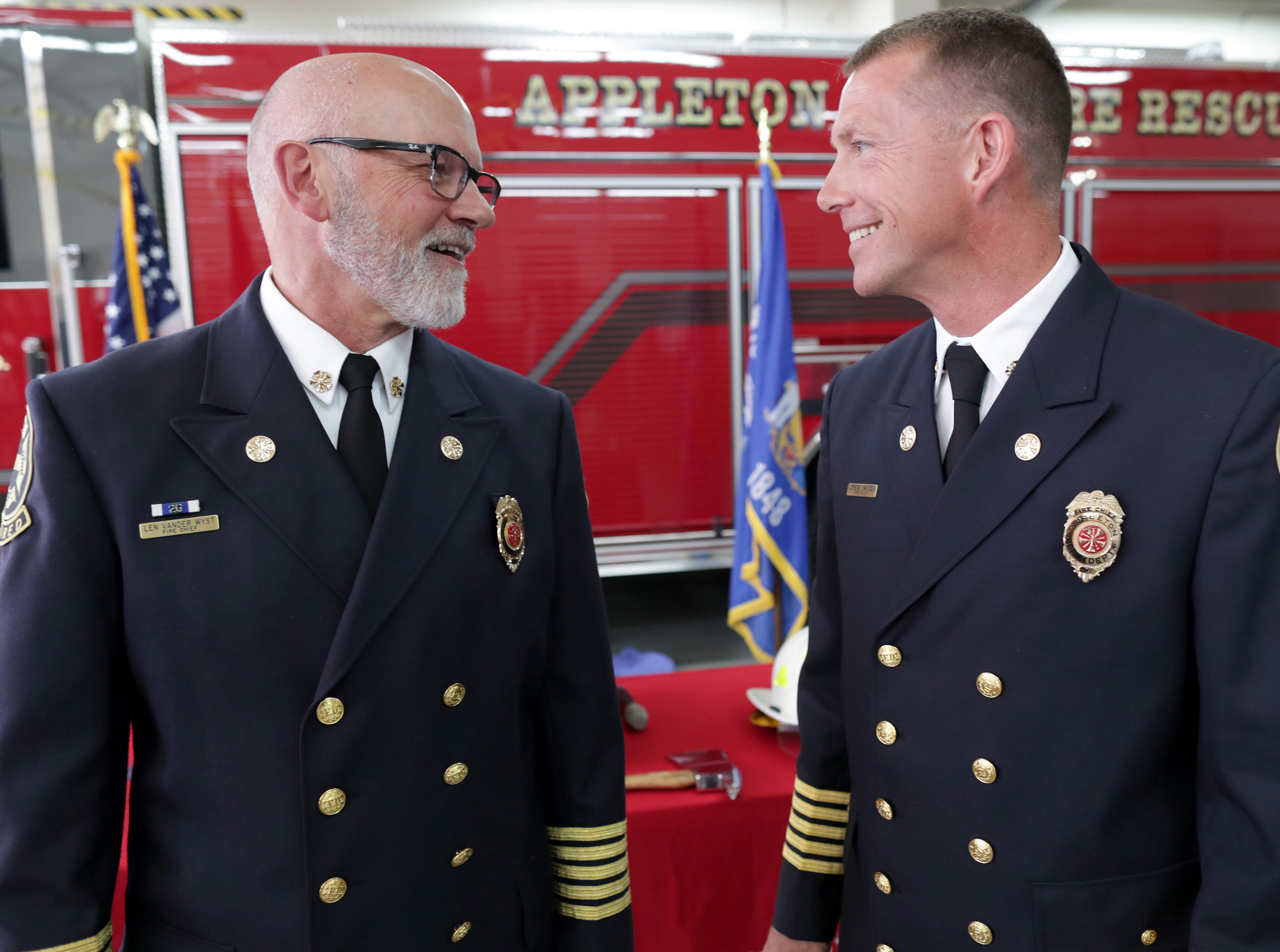Retired Appleton Fire Chief Len Vander Wyst, left, talks to  new Fire Chief Jeremy Hansen in  follwing a swearing in ceremony on Monday, July 16, 2018 at Fire Station 1 in Appleton, Wis. 